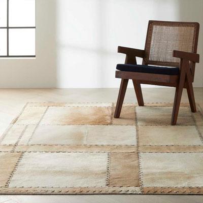 tan pattern area rug